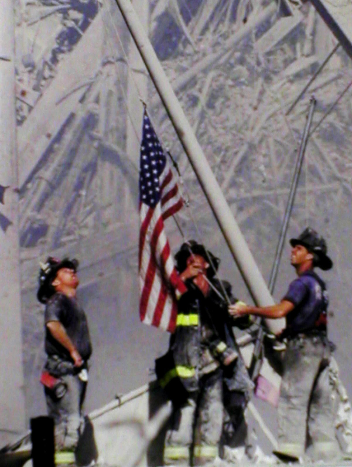 US Firemen Raise Flag after 911 in New York